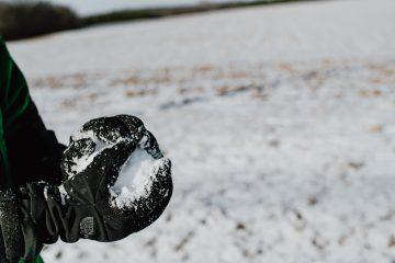 black heart shaped ornament on white sand
